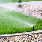 Green Grass Lawn Sprinklers profile image.