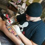Auris tattoo art profile image.