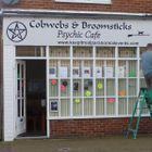 Cobwebs and Broomsticks Psychic Cafe
