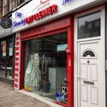 Exclusive Drycleaning & Tailoring profile image.