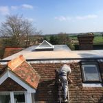 Covered roofing profile image.