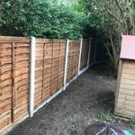 Sure-Wood Fencing and Landscapes profile image.